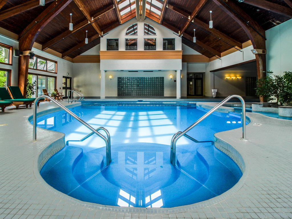 Indoor pool and hot tub  Killington Holiday House: A shared indoor pool, hot tub, gym & shuttle