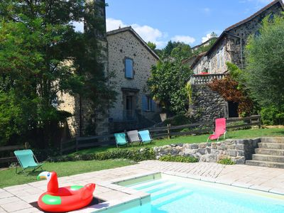 Photo for Semi-detached house with a large grass garden, pool and next to the Ardèche