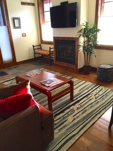 Relax in front of the fireplace after a day of skiing or hiking nearby trails.