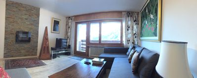 Photo for Newly renovated apartment with scenic views in Swiss ski/hot bath resort