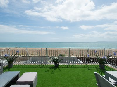 Photo for A stone's throw from the beach with fab sea views makes this the perfect getaway