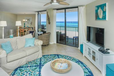 Living room opens to dining and kitchen with full view of ocean from every seat.
