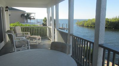 Photo for Gulf view on channel, kayak, fishing, sunsets on the deck - great family space!