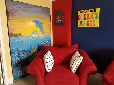 OCEAN'S MAGIC with beautiful  mural of leaping dolphins on pull out murphy bed