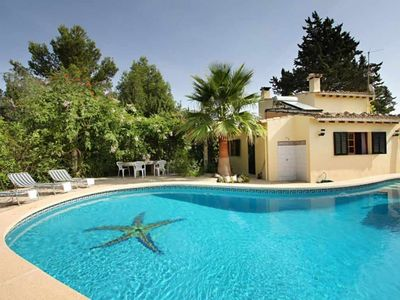 Photo for Flirty cottage surrounded by forest with pool 7 km from the sea