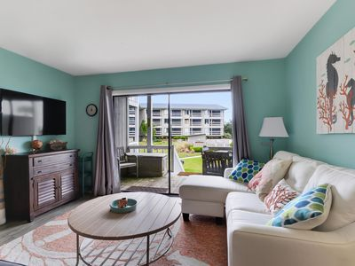 Photo for Beach Condo Steps from Island Amenities and Beach
