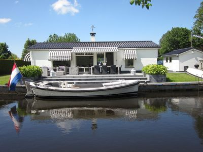 Photo for Luxurious holiday home along public swimming/sailing waters near Langweer