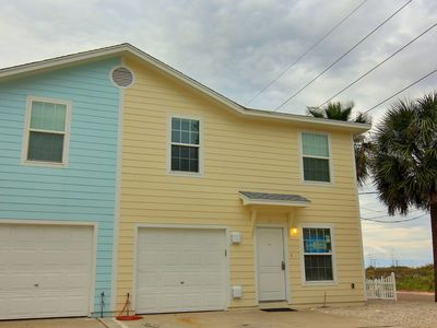 Photo for 4 Bedroom 3 Bath condo just steps to the beach!