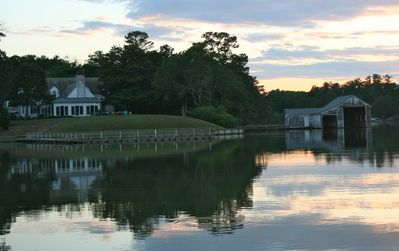 View from the water of house and boat house