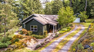 Casa Verde entry driveway showing covered rear porch and wonderful forest setting