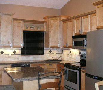 New kitchen:granite countertops, birch cabinets and stainless steel appliances