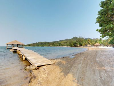 Photo for NEW LISTING! Tropical oceanview villa, with a shared pool and dock access