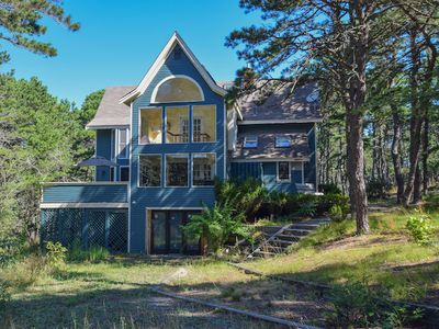 Photo for #312: Modern, private, secluded, walking path to water, close to the beach!