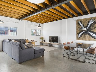 Photo for Stunning warehouse apartment with parking - walk Salamanca & MONA ferry