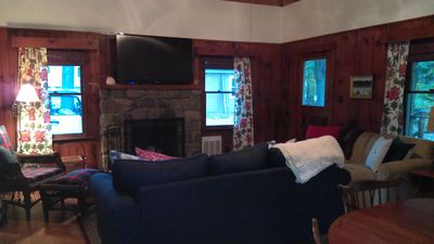 """Great room with stone fireplace, 55"""" tv and full size sofa sleeper"""