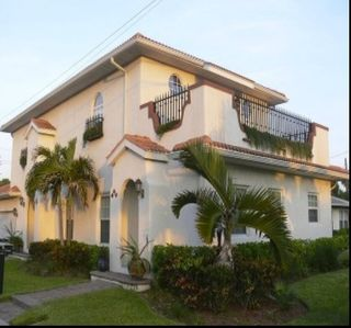 Newer Spanish style residence. 3 large bdrms & 3  bths just steps to the beach.