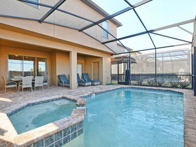 Photo for BEAUTIFUL BRAND NEW HOME WITH JACUZZI IN A RESORT COMMUNITY JUST A FEW MINUTES FROM DISNEY!