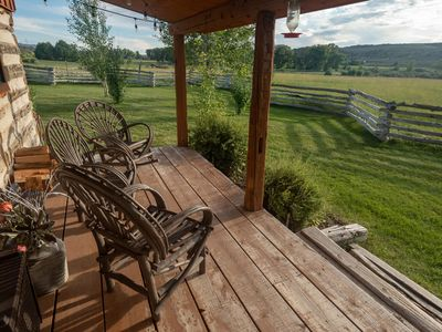 Photo for 1 BR Log Cabin | Front porch overlooking vast meadow | Pond | Horses | Kitchen