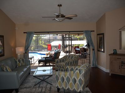 Photo for Stunning Cape Coral 3 Bed 2 Bath, SW exposure, heated Pool, direct access canal