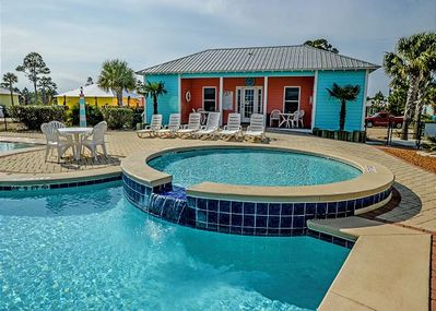Outdoor Pool #1 - Outdoor Pool #1 offers plenty of seating whether you choose to lounge or sit at a table. This pool also offers a small clubhouse with a restroom facility