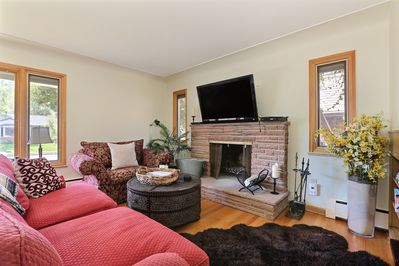Can't beat relaxing by the fire in this comfortable living room!