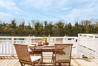 The private deck is a perfect spot for alfresco dining or simply to relax