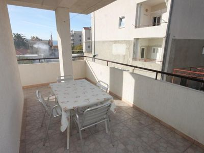 Photo for Studio flat with terrace Dugi Rat, Omiš (AS-7481-c)