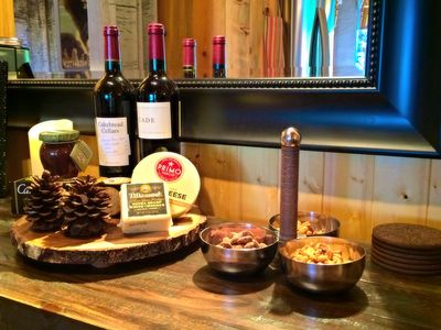 You will be greeted with a welcome bottle of wine and cheese (and more)!