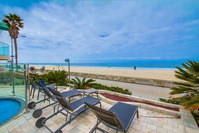 Guests Can Enjoy a Oceanfront Shared Patio.