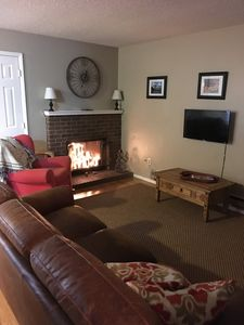 Living room with candle-filled fireplace