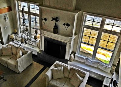 View of living room & gas fireplace from upper level.