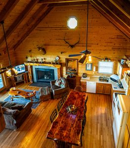 Main level has Full Kitchen, Dining Area,  1 of 2 Living Rooms & Wood Fireplace.