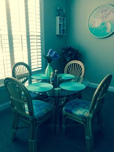 Enjoy your coffee on this lovely glass top table with 5 chairs.