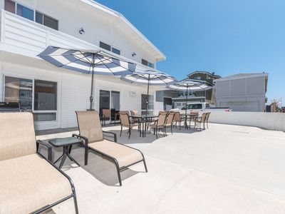 Photo for Enjoy the largest patio on Seashore Dr. - just one house from the popular 40th Street beach!