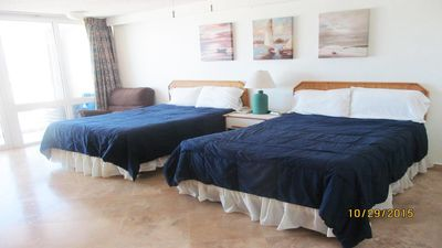Two Full Size Beds With Rattan Headboards