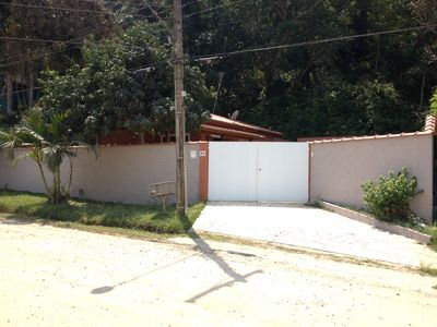 Photo for Cozy !!! House with pool in closed condominium near the beach.