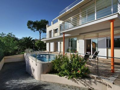 Photo for Modern villa with private pool, beautiful setting overlooking the sea
