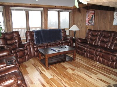 Hickory floors in living room, coffee table rolls and raises for dining. Views!