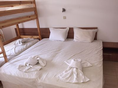 Bedroom with double bed and bunk beds