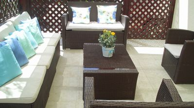 Enclosed patio seating area to front