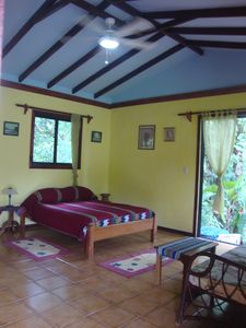 Queen bed with orthopedic new mattress, tile floors,screened room, high ceiling.
