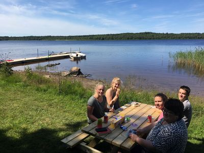 Photo for Cottage on the lake with boat, internet, sat tv, dishwasher, oven ...