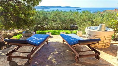 Photo for Amazing sea view, surrounded by local herbs, olive trees and wild nature