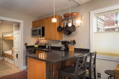 Eat-in kitchen with 2 bar stools