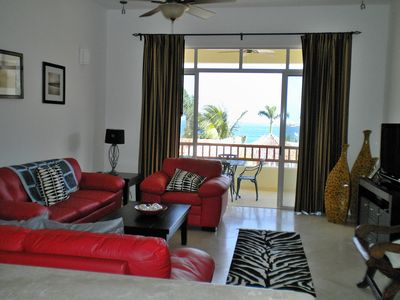 Living area with flat screen TV and the Pacific