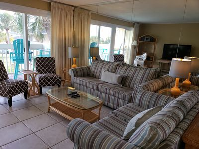 The open floor-plan makes entertaining and spending time together, easy and convenient. The dining table seats an additional four and the cool, tile floors throughout the unit add to the beach ambiance.