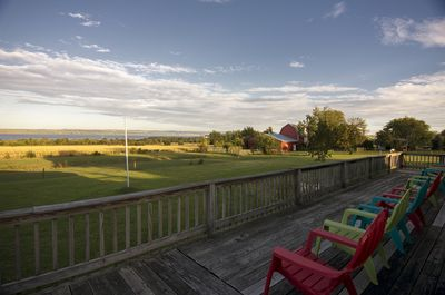 Unwind on the deck overlooking our 2 acre lawn and stunning lake view!