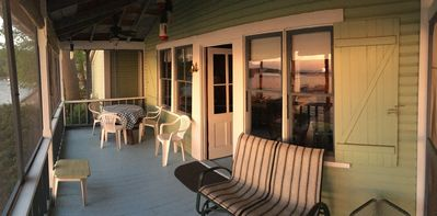 Screened in porch over with overhead fans...  perfect for those gorgeous sunsets