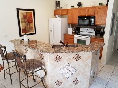 Photo for 4 Bed w/private pool at luxury resort, minutes from Disney!