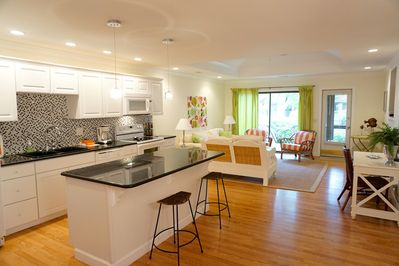 Beautiful renovated kitchen with island and granite countertops.